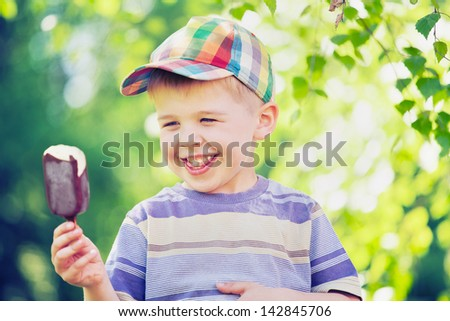 excited kid with chocolate ice cream - stock photo