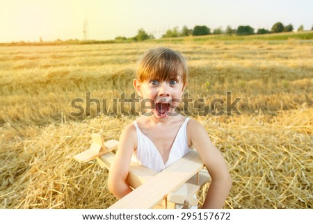 Excited little girl in the wheat field.  - stock photo