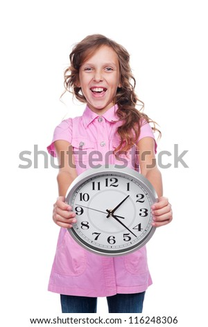 excited little girl showing clock. studio shot over white background - stock photo