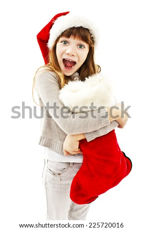 Excited Little girl with Christmas gift. Isolated on white background - stock photo