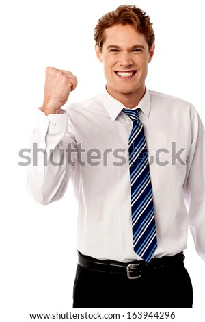 Excited male manager rejoicing on his victory - stock photo