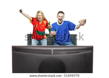 Excited man and woman watching sport on a TV isolated on white background - stock photo