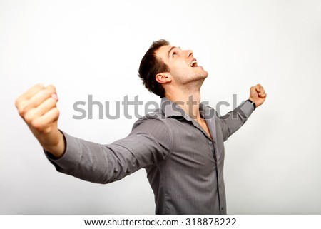 Excited man happy for his win and success - stock photo