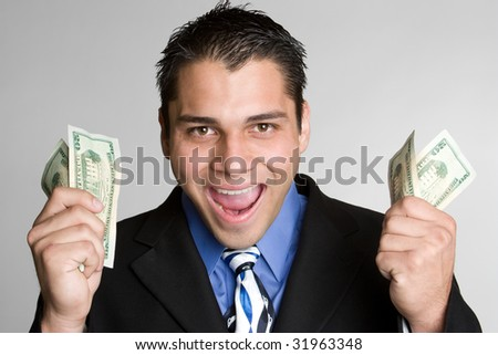 Excited Man Holding Money - stock photo