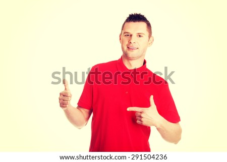 Excited man showing copy space on his hand - stock photo