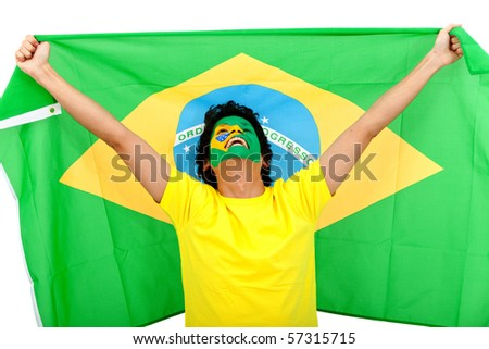 Excited man with the Brazilian flag painted on his face - stock photo