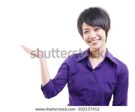 Excited mixed race Asian woman showing her empty palm on white background - stock photo