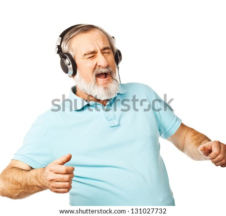 Excited old man listening to music with headphones on white background - stock photo