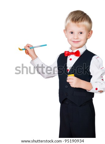 excited painting boy wearing classic suit isolated on white background - stock photo