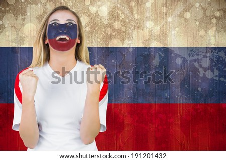 Excited russia fan in face paint cheering against russia flag in grunge effect - stock photo