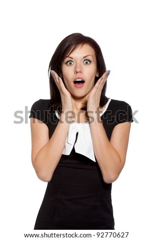 excited scared, terrified woman, young girl surprised wear black dress with white bow, looking at camera, isolated over white background - stock photo