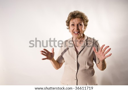 Excited senior woman with wide grin - stock photo