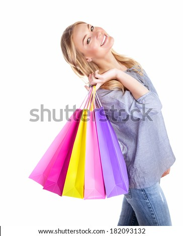 Excited shopper, cheerful girl holding in hand colorful gift bags isolated on white background, hobby of spending money, sales concept - stock photo