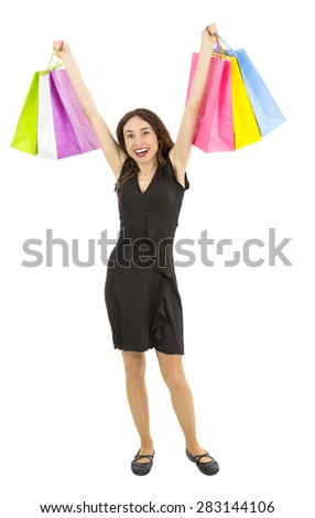 Excited shopping woman cheering - stock photo
