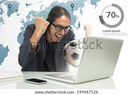 Excited soccer fan watching a game on laptop