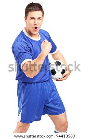 Excited sport fan holding a football and gesturing isolated on white background - stock photo