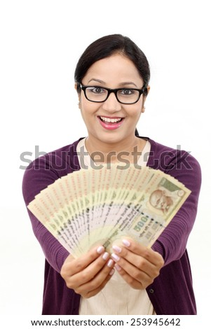 Excited successful young woman holding Indian rupee bills - stock photo
