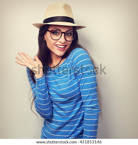 Excited surprising fun young woman in eye glasses and fashion straw hat. Vintage toned portrait - stock photo