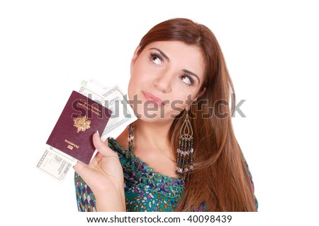 Excited traveler with her passport and money in her hand