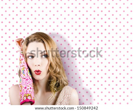 Excited woman cook posing with open mouth and oven mitt while looking to polka dot menu and recipe copy space - stock photo