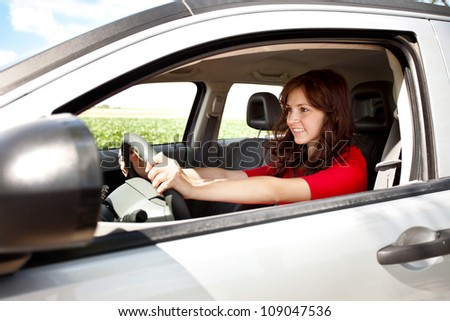 Excited woman driving her new car