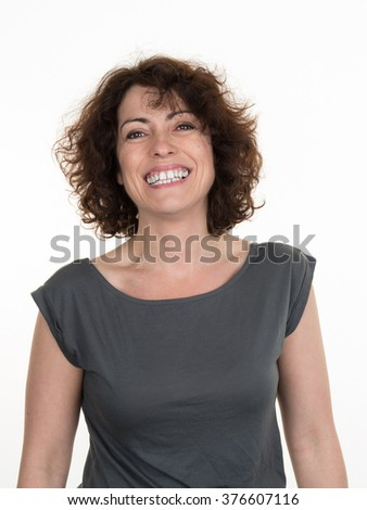 Excited woman happy smile, girl portrait looking at camera toothy smiling isolated  - stock photo