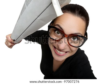 Excited woman in glasses with newspaper on a white background - stock photo