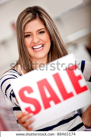 Excited woman shopping on sale at a retail store