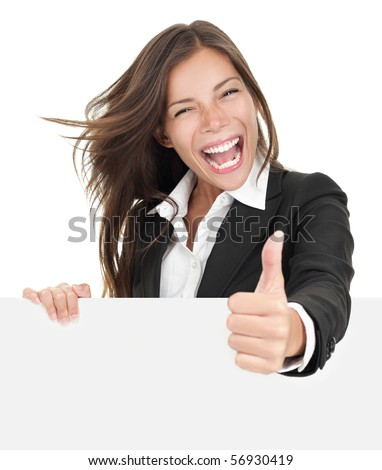 Excited woman thumbs up with blank poster sign. Young businesswoman mixed asian caucasian ethnicity. - stock photo