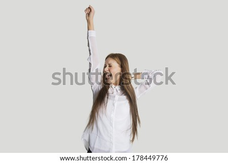 Excited woman with arm raised screaming against white background - stock photo