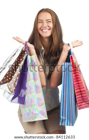 Excited woman with colorful shopping bags in her hands - stock photo