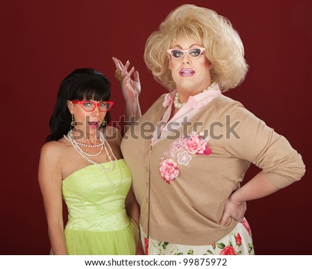 Excited woman with drag queen wearing thick eyeglasses