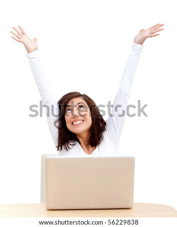 Excited woman with laptop and arms up