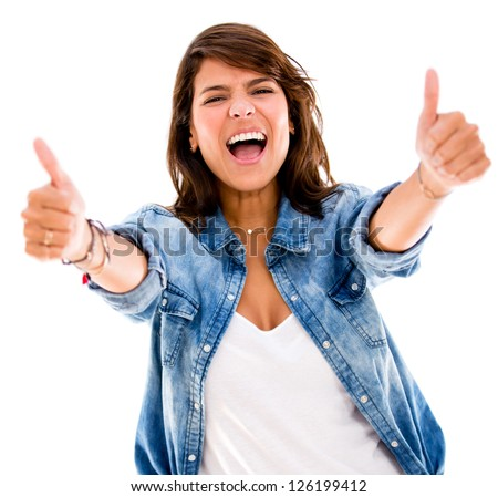 Excited woman with thumbs up - isolated over a white backgorund - stock photo