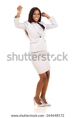 excited young african woman dancing over white background - stock photo