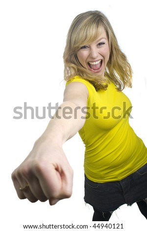 Excited Young Blonde Woman Punching - stock photo