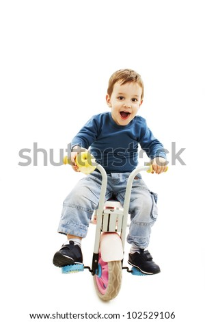 Excited young boy on bike. Isolated on white background.