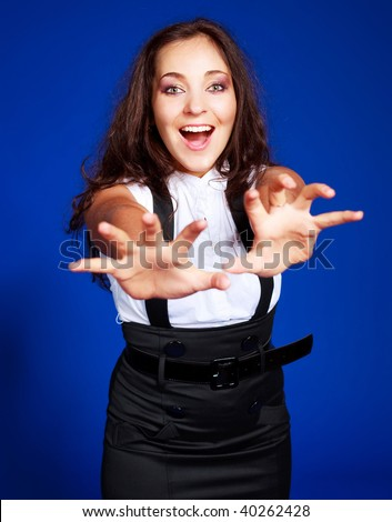 excited young brunette woman stretching her hands to us