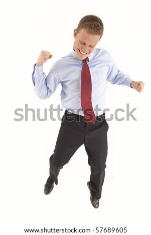 Excited young businessman - stock photo