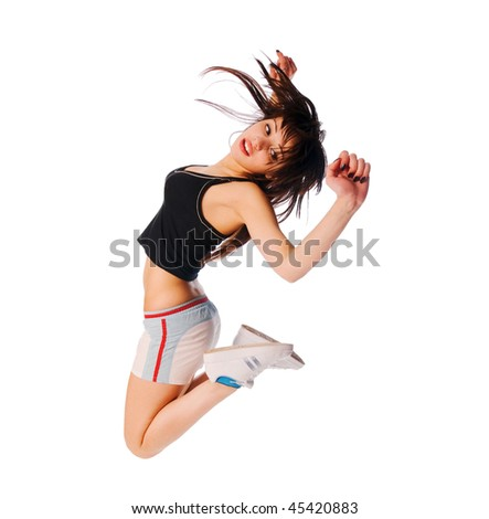 Excited young girl jumping on white background