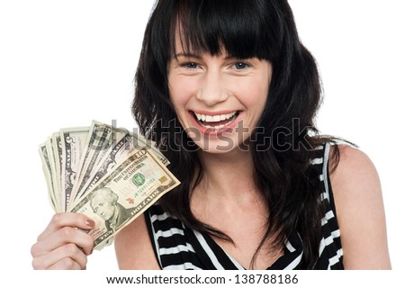 Excited young girl with cash isolated on white.