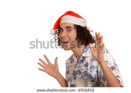 excited young man celebates Christmas in santa hat - stock photo