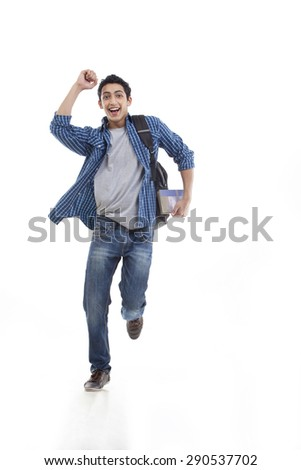 Excited young man running over white background - stock photo