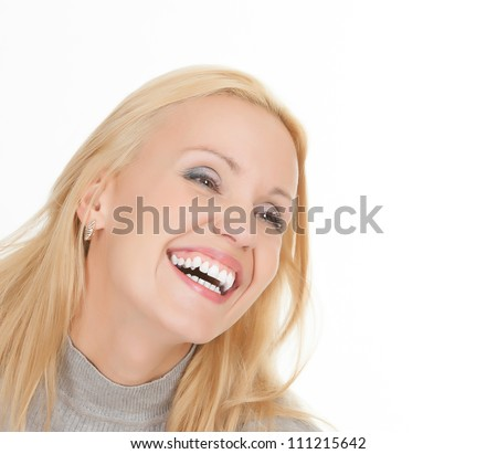 excited young woman laughing against white background - stock photo