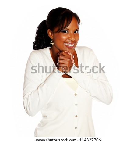 Excited young woman looking at you on isolated background - stock photo
