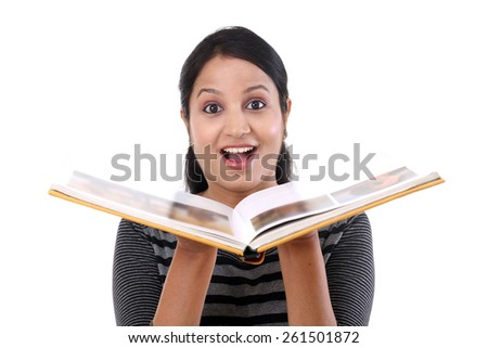 Excited young woman reading a book - stock photo