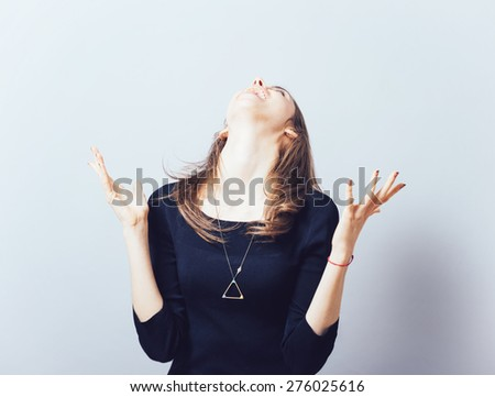 Excited young woman with fists up - stock photo