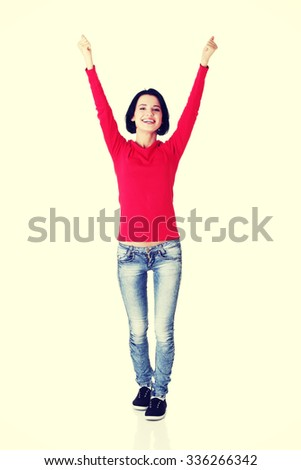 Excited young woman with fists up. - stock photo