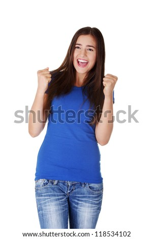 Excited young woman with fists up ,isolated on white - stock photo