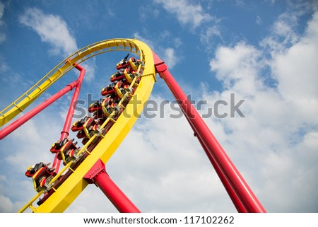 Exciting Roller Coaster in amusement park - stock photo